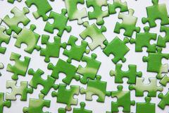 scattered green puzzle - stock photo