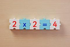 Stock Photo of educational blocks with math problems on the table