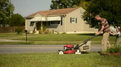 Helping Daddy Mow - stock footage