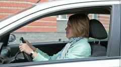 Female driver in vehicle Stock Footage