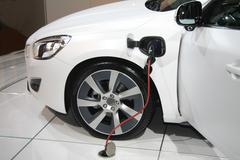 white hybrid car on recharge - stock photo