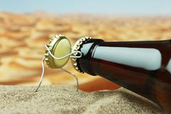 Stock Photo of funny bottle cork on a sandy beach
