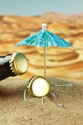 funny bottle cork on a sandy beach - stock photo