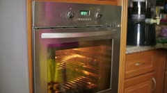 Cooking in oven Stock Footage