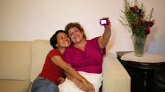 mother daughter taking own picture at home - stock footage