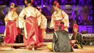 Stock Video Footage of SARAWAK, MALAYSIA - JUNE 2012: Iban and Malay tribal performance