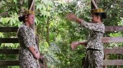 SARAWAK, MALAYSIA - JUNE 2012: Iban tribal girls in longhouse Stock Footage