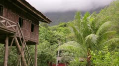 Tribal borneo houses Stock Footage