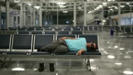 Stock Video Footage of sleeping in airport with eye cover