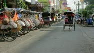 Stock Video Footage of JOGJAKARTA - MAY 2012: transportation with cyclo