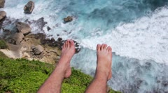 Suicidal young man at the edge of cliff Stock Footage