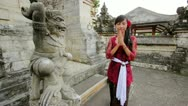 Stock Video Footage of balinese girl saluting with both hand in uluwatu temple, bali
