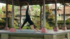 Caucasian woman meditating yoga in balinese temple Stock Footage