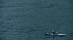 Walking at the sea kayaks Stock Footage