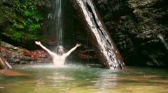 Caucasian man enjoying in waterfall under water Stock Footage