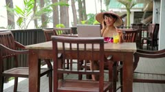 Asian freelance business woman at cafe with laptop and phone Stock Footage