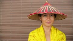 Attractive asian lady with hat Stock Footage