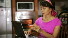 Woman buying with credit card, online shopping in kitchen Stock Footage