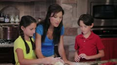 Mom, Son, Daughter Baking Cookies Stock Footage