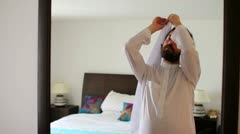 Saudi arabian man dressing at home - stock footage