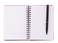 Open blank checked notebook with black pen Stock Photos