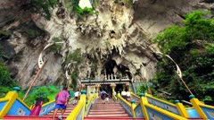 Stock Video Footage of KUALA LUMPUR - MARCH 2012: people climbing batu caves steps