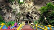 KUALA LUMPUR - MARCH 2012: people climbing batu caves steps Stock Footage