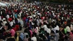 MALAYSIA - 2012: Crowded people watching tv in kuala lumpur - stock footage