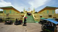 Stock Video Footage of PENYENGAT ISLAND - MAY 2012: people at Sultan Riau Mosque. Walls painted with