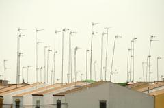 houses and antennas - stock photo