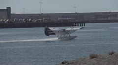 Slo-mo (true slow motion 120 FPS) float plane takeoff in harbour Stock Footage