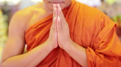Buddhist monk with orange robe pray in temple Stock Footage