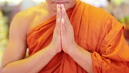 Stock Video Footage of buddhist monk with orange robe pray in temple