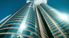 Skyscrapers over blue sky, loopable - stock footage