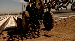 Farm Tractor maintenance worker working immigration reform job outdoors Stock Footage