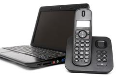 Netbook and decked telephone Stock Photos