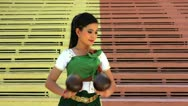 Beautiful Asian Girl performs coconut folk dance in temple Stock Footage