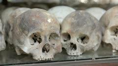Skulls and bones in Killing field, cambodia, static camera Stock Footage