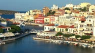 Stock Video Footage of Aerial view of city Agios Nikolaos before sunset, Crete