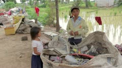 Garbage gatherer childs in cambodia Stock Footage