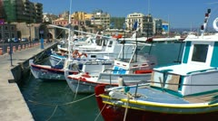 Boats in harbor near Venetian Fortress Koules, Heraklion, Crete - stock footage