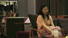 Young Asian Woman at cafe place drinks coffee tea Stock Footage