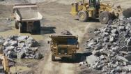 Stock Video Footage of Open pit mine activity zoom in
