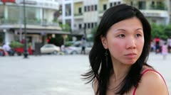 Chinese young woman looking for something at city Stock Footage