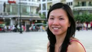 Happy chinese young woman in city center Stock Footage
