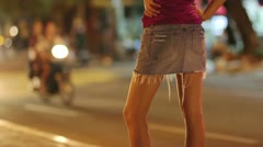 Prostitute waiting for costumer on street at night Stock Footage