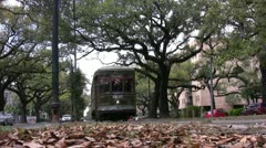 New Orleans street car passes tilted up from ground POV Stock Footage