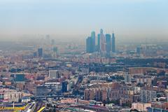 Moscow city and cityscape in smog autumn day Stock Photos