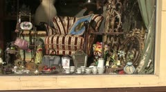 Antique shop window in town street Stock Footage