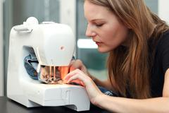 young woman sewing - stock photo